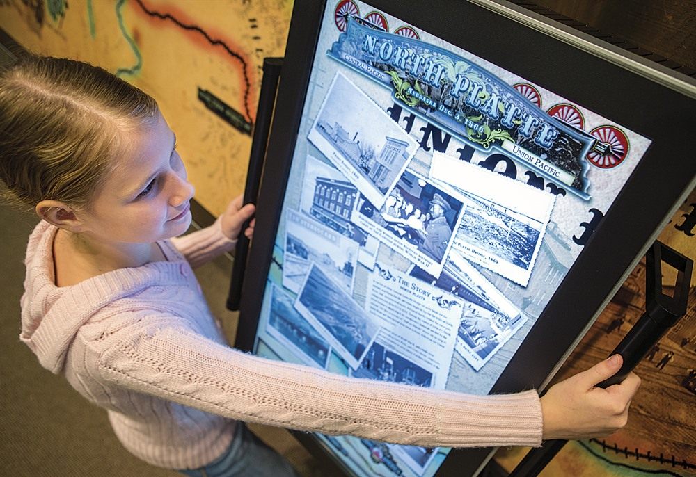 A girl explores the timeline of the construction of the Transcontinental Railroad.