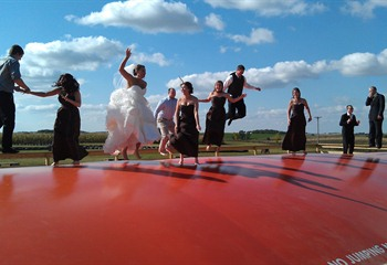 Wedding party on jumping pillow